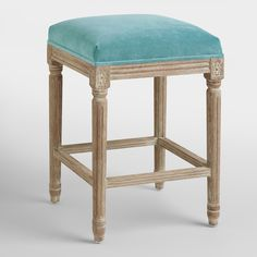 An elegant take on a classic, our Peacock Paige Backless Counter Stool is crafted of American white oak with carved details and a distressed finish. Pull this exclusive velvet upholstered stool up to the bar or kitchen for a stylish seating update.