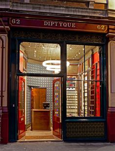 Christopher Jenner's new London store design for Dyptique. Stained glass, secret cupboards and Gothic revival wallpapers. Love it.