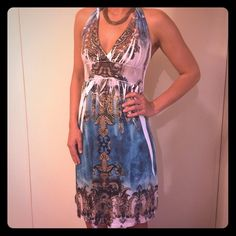Dress with tie around halter top Boho style gorgeous dress. Great for the spring or summer. It has multiple colors with subtle embellishments. It is super comfortable and is very flattering. Worn once and is in perfect condition. The fabric is 95% polyester and 5% spandex Cristinalove Dresses Midi
