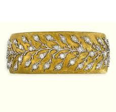 A DIAMOND-SET BANGLE, BY BUCCELLATI......I'm not much on diamonds, but I do like this