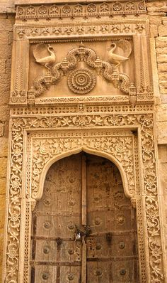 Architecture ( Wood carved doors with peacocks in the old walled town of Jaisalmer, Rajasthan, India. Temple Architecture, Islamic Architecture, Amazing Architecture, Architecture Design, Jaisalmer, Portal, Door Knockers, Beautiful Buildings, Incredible India