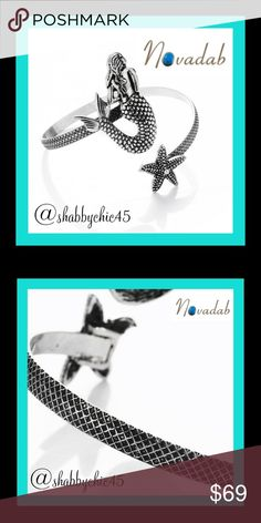 """Mermaids & Starfish Bangle Bracelet This Mermaid Starfish Bangle features a real pearl and is the perfect accessory for summer. Whether you're headed for the beach, the pool, or the nightlife, this piece is bound to make an impression.  Mermaid bangle is made up of alloy meta lMermaid measurement 1.5"""" x 1"""" Starfish measurement .79"""" x .79"""" Inner diameter 2.4"""" Weight 21 grams  Smoke free home Novadab Jewelry Bracelets"""