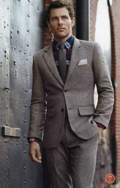 Shop this look for $176:  http://lookastic.com/men/looks/blazer-and-dress-pants-and-dress-shirt-and-tie-and-pocket-square/1515  — Grey Blazer  — Grey Wool Dress Pants  — Navy Plaid Dress Shirt  — Charcoal Tie  — Grey Pocket Square