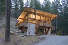 Built by Balance Associates Architects in Okanogan, United States with date 0. Images by Steve Keating Photography. Wintergreen Cabin is a 1,600 sqf cabin built into a steep hillside overlooking a stream with a view to the mountains ...