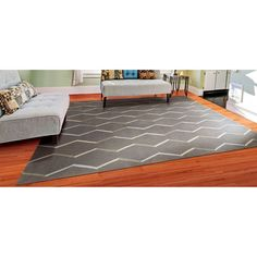 A modern, minimalist design is finely hand carved into this marvelous hand tufted rug for an unsurpassed tone, texture and dimension. Its glowing shades of lush grey and splendid gold lend a timeless and awe-inspiring elegance to any interior.