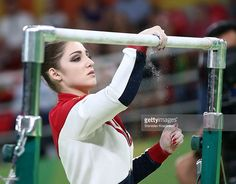 artistic-gymnasts-aliya-mustafina-russia-prepares-the-uneven-bars-for-picture-id589514552 (1024×800)