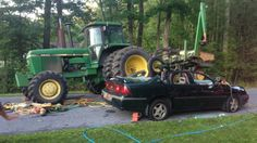 Aftermath of crash involving John Deere tractor and car in Delaware on July 18th, 2014. (credit: Delaware State Police)