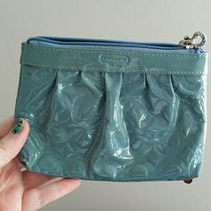 Authentic COACH blue patent wristlet Super cute baby blue monogram patent material, gold silk lining on inside. No rips. Minimal fading and a few dark stains on the front (may come off but I haven't tried) but EUC other than that. Zip closure, leather wrist strap, inside pocket Coach Bags Clutches & Wristlets