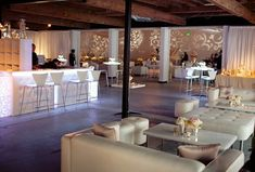 love this idea of chairs, couches and stools for a reception