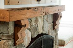 Longleaf Lumber - reclaimed oak mantel custom-milled from a salvaged hand-hewn beam for a home in Rockport, Massachusetts.