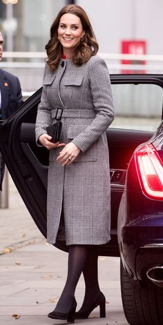 Kate Middleton stayed true to her timeless style, wearing a classic houndstooth coat paired with black stockings, pumps, and clutch.