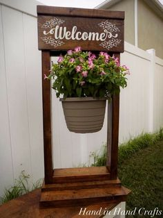Now available is this hand painted wooden plant stand. The stand is approximately 36x11 and comes ready for you to hang your basket of flowers (flowers not included). 4 different welcome signs available and for $5 more we can put a different saying on the backside! Order yours today!