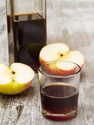 Glass of real organic apple cider vinegar - great for gout relief and arthritis