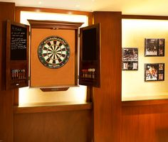 "Love this dart board.and the rules: ""If you hit wood you can't play."" That's the main thing that would freak me out about darts in this basement. Strand Basement - contemporary - basement - About:Space, LLC Basement Games, Basement Ideas, Video Game Rooms, Video Games, Bedroom Setup, Game Room Decor, Gamer Room, Dart Board, Billiard Room"