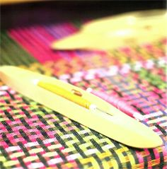fabric on the loom at Margo Selby's workshops