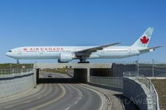 Air Canada Boeing 777-300ER (C-FITW) from London Heathrow arriving over the new taxiway romeo bridge at Calgary - 2014