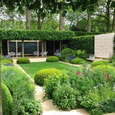 A modern take of a formal English/ Italian garden.