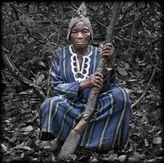 Africa | The Nagô Hunters of the Bantè Kingdom, established in the fourteenth century, form a brotherhood of hunters, placed under the authority of a traditional King. The Kingdom is located in the heart of Benin, in the Bantè forest, the Collines Department. The 27 villages of the Kingdom comprise Chiefs Hunters | ©Jean-Dominique Burton