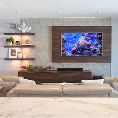 A custom wall was designed and installed using porcelain tile, floating cabinetry, shelves and wood paneling creating a stunning entertainment wall unit. Floating Entertainment Center, Built In Entertainment Center, Tv Wall Design, Wood Design, House Design, Floating Wall Unit, Wood Tv Unit, Kitchen Wall Units, Tile Accent Wall