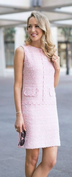 It's all in the details with this iconic pink tweed sleeveless shift dress that has the most beautiful braided trim and perfect notched hem.
