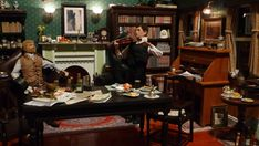 A 1/6th scale representation of the sitting-room from 221B Baker Street - the residence of Dr John Watson and Mr Sherlock Holmes, utilising vintage Palitoy Action Man figures.