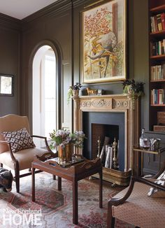An antique mantle stands out against dark and moody walls. Interior design: Leslie Rylee, Leslie Rylee Decorative Arts & Interiors, Architectural design and construction: Dennis Fisher, Amber Construction & Design, Photography: Michael Partenio