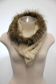 Cable knit infinity scarf with fur edge. Available color: Off-white