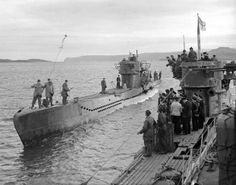 German u boat U-236 coming alongside U-826 while flying the white ensign, for inspection by British naval officers at Loch Eriboll, Scotland. Before surrendering U-826 had been on operational duties for more than five weeks.