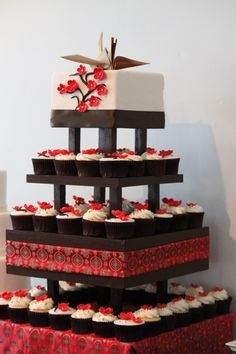 Awesome japanese party decorations 10 asian theme party ideas wedding cake with cranes and cherry blossoms was invited by cake central magazine to create junglespirit Images