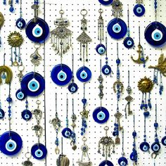 Greek amulets with apotropaic function (protection from the evil eye, i.e. malicious jealousy). They can be worn by people or hung on walls, esp. above the house's entrance door.