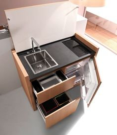 Micro kitchen that looks like cabinetry when it's closed.  K1 DETAIL INTERIEUR