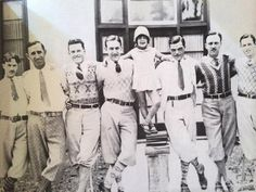 Dapper Days! Margie Gay poses with (left to right) Ham Hamilton, Roy Disney, Hugh Harman, Walt Disney, Rudy Ising, Ub Iwerks, and Walker Harman. (Courtesy of Vintage Disney Parks)