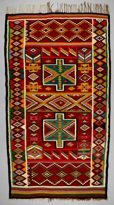 Africa | Floor rug from Sidi Bou Zid, Tunisia | ca. 1950 - 60 | Wool; weft-faced, interlocking tapestry woven. | Tunisian kilims were woven both for use in the home and for sale in the market, the kilim has long functioned as a decorative furnishing in the house or tent. It is also a key item in a young woman's trousseau and a source of income for the family.