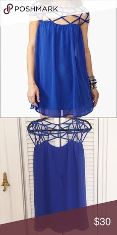 Blue Cage Top Dress Gorgeous dress for that summer party you may have to attend. Do u like to wear something with a cute top that shows in your selfie pic? Then this is the perfect dress for you. Label large but the inner lining is cut small and does not stretch so will fit medium better. NWT Dresses