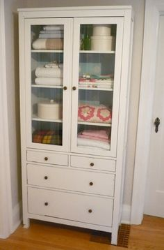 DIY Linen Closet — Ikea Hemnes cabinet makeover // House & Home Can also create a kitchen organizer by adding S hooks and a rod for hanging pots!