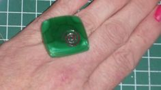 green ring with copp er r inclus I on
