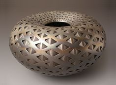 """Like the precision and artistry of this piece. """"Black Diamond Donut""""- Ceramic Vessel by Michael Wisner. Hand coiled and formed earthenware vase that is flawlessly incised with a rhythmic texture and pattern. Built from Colorado clay and pit fired."""