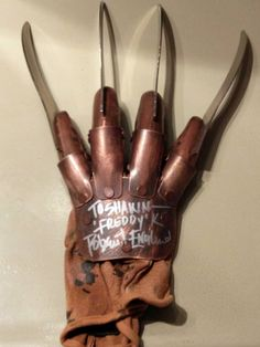 Freddy glove signed by Robert Englund