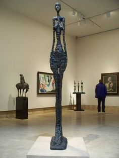 bronze tall figure by Alberto Giacometti