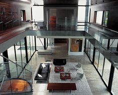 I like the idea of this living room being an atrium/central open space