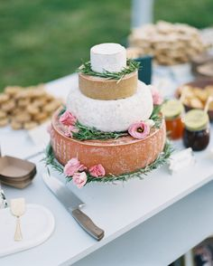 A wedding cake of stacked cheese wheels is the greatest thing I've ever seen on any wedding post ever.