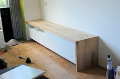Besta media unit with bench seating: covered with oak countertop material, cut to size. Note mitered corner