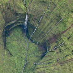 """Mount Waiʻaleʻale is a shield volcano and the second highest point on the island of Kauaʻi in the Hawaiian Islands. Its name literally means """"rippling water"""" or """"overflowing water"""". The mountain, at an elevation of 5,148 feet (1,569 m), averages more than 452 inches (11,500 mm) of rain a year since 1912, with a record 683 inches (17,300 mm) in 1982; its summit is one of the rainiest spots on earth.  The best way to experience this beauty? A helicopter tour with @bluehawaiianhelicopters…"""