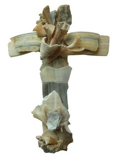 These grand works of art are so beautifully sculptured; they appear as fine china. The exquisite Crosses are totally sculptured from naturally broken seashells found by the artist on the beach. The seashells are never altered and are used exactly as found. There are no forms nor molds...each Cross is uniquely sculptured. Creating the hats is wonderful, but this new venture is really exciting. Each day that we lived on the beach, I collected broken pieces of seashells for my handcrafted sculpt... Cross Wall Decor, Crosses Decor, Wall Crosses, Catholic Confirmation Gifts, Prayer Crafts, Beach Wedding Gifts, Cool Artwork, Amazing Artwork, Orange Beach