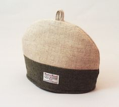 "Harris Tweed tea cosy, teapot cover cream and green fabric tea cozy. This beautiful quality cosy has been handmade from the world renowned Harris Tweed handwoven fabric. I have used two colours of ""plain"" design, which actually have a mottled. Harris Tweed Fabric, Teapot Cover, Tea Cozy, Green Fabric, White Cotton, Christmas Fun, Cosy, Hand Weaving"