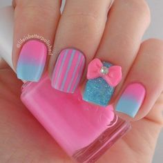 A cotton candy inspired pink nail art design. Predominantly pink, blue polish is also used to compliment the pink color. Gradient styles as well as stripes are also used in the design.