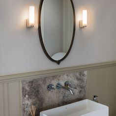 The Tulsa IP44 Bathroom Wall Light has a Polished Chrome Finish and Frosted Glass Shade. Suitable as a Wall Light or Mirror Light. Astro 0327