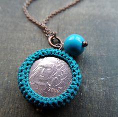 Crochet pendant around a 2 Euro coin.