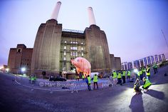 "LONDON, ENGLAND - SEPTEMBER 26: General view of the Pink Floyd pig made famous on the sleeve of the 1976 album ""Animals"" being inflated to fly again over Battersea Power Station 35 years later at Battersea Power station on September 26, 2011 in Londo Classic Rock  Rock on!"