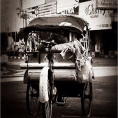 Becak in Jalan Malioboro, Yogyakarta. Becak is tricycle serves as major public transportation in this city and many places in Indonesia